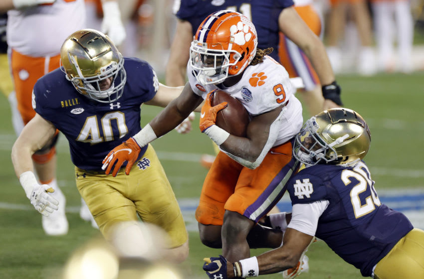 CHARLOTTE, NORTH CAROLINA - DECEMBER 19: Running back Travis Etienne #9 of the Clemson Tigers runs on his way to scoring a 44-yard touchdown in the second quarter against the Notre Dame Fighting Irish during the ACC Championship game at Bank of America Stadium on December 19, 2020 in Charlotte, North Carolina. (Photo by Jared C. Tilton/Getty Images)