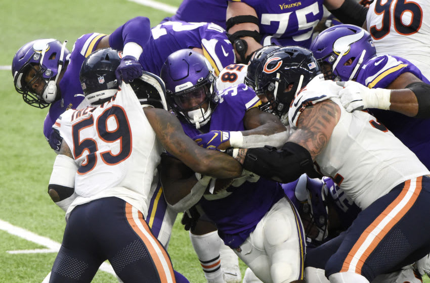 MINNEAPOLIS, MINNESOTA - DECEMBER 20: Dalvin Cook #33 of the Minnesota Vikings carries the ball during the second half against the Chicago Bears at U.S. Bank Stadium on December 20, 2020 in Minneapolis, Minnesota. (Photo by Stephen Maturen/Getty Images)