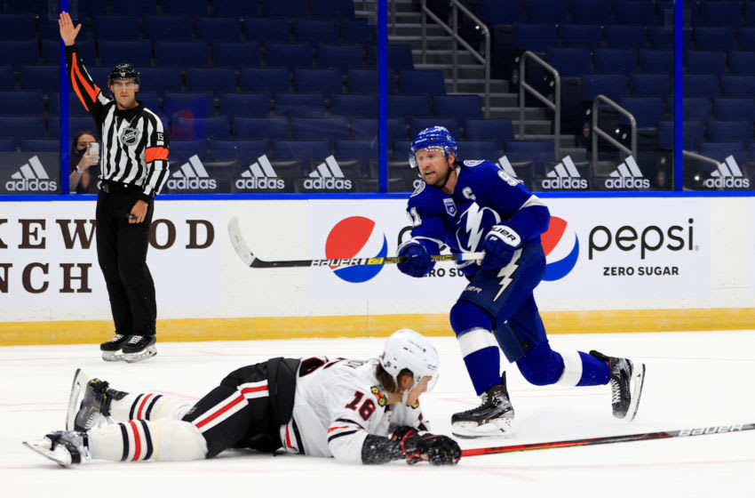 TAMPA, FLORIDA - JANUARY 13: Steven Stamkos #91 of the Tampa Bay Lightning looks to pass during a game against the Chicago Blackhawks on opening night of the 2020-21 NHL season at Amalie Arena on January 13, 2021 in Tampa, Florida. (Photo by Mike Ehrmann/Getty Images)