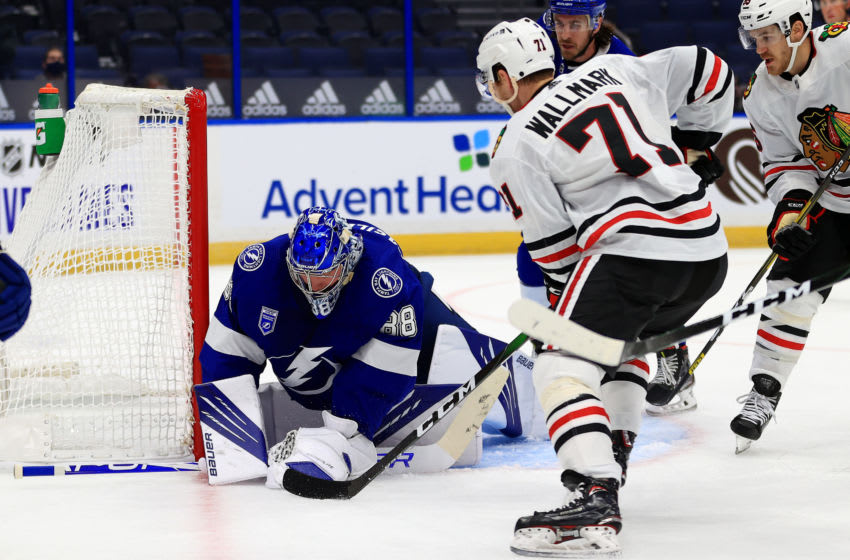 TAMPA, FLORIDA - JANUARY 13: Andrei Vasilevskiy #88 of the Tampa Bay Lightning stops a shot from Lucas Wallmark #71 of the Chicago Blackhawks during a game on opening night of the 2020-21 NHL season at Amalie Arena on January 13, 2021 in Tampa, Florida. (Photo by Mike Ehrmann/Getty Images)