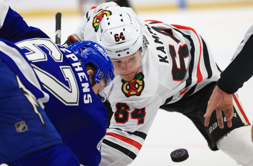 TAMPA, FLORIDA - JANUARY 13: David Kampf #64 of the Chicago Blackhawks faces off against Mitchell Stephens #67 of the Tampa Bay Lightning during a game on opening night of the 2020-21 NHL season at Amalie Arena on January 13, 2021 in Tampa, Florida. (Photo by Mike Ehrmann/Getty Images)