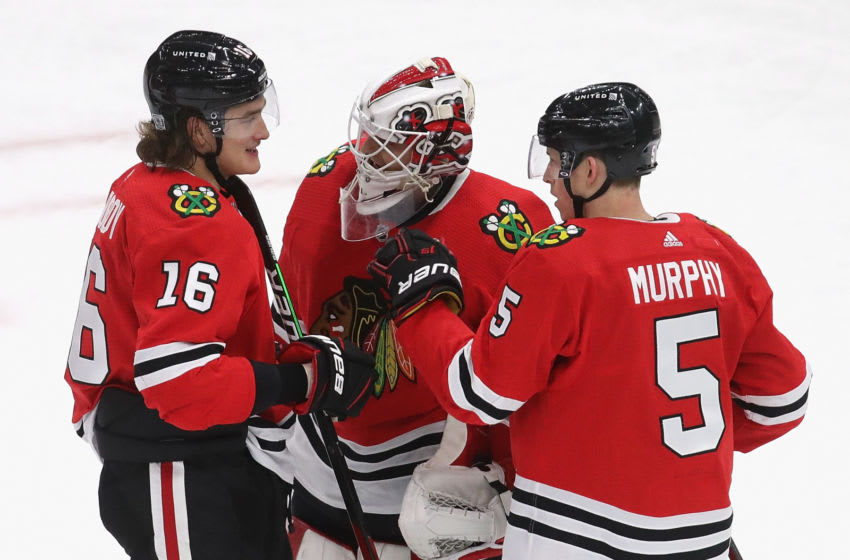 CHICAGO, ILLINOIS - JANUARY 31: (L-R) Nikita Zadorov #16, Kevin Lankinen #32 and Connor Murphy #5 of the Chicago Blackhawks celebrate a win over the Columbus Blue Jackets at the United Center on January 31, 2021 in Chicago, Illinois. The Blackhawks defeated the Blue Jackets 3-1. (Photo by Jonathan Daniel/Getty Images)