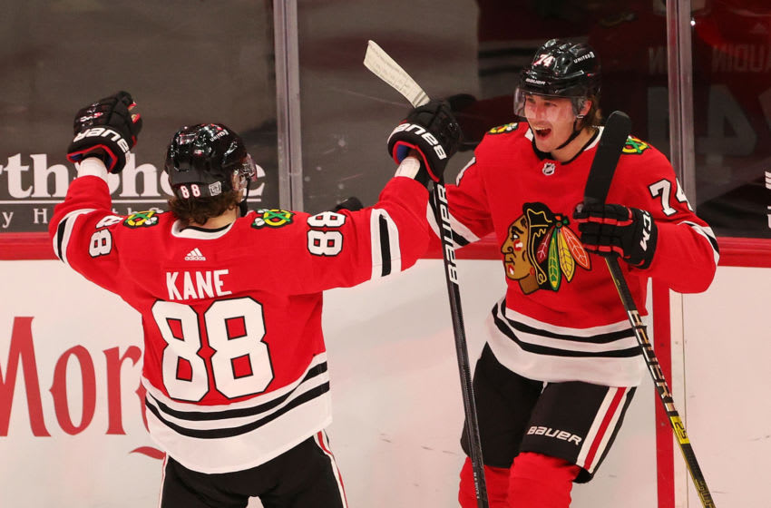 CHICAGO, ILLINOIS - FEBRUARY 11: Nicolas Beaudin #74 of the Chicago Blackhawks celebrates his first goal with Patrick Kane #88 during the second period against the Columbus Blue Jackets at the United Center on February 11, 2021 in Chicago, Illinois. (Photo by Stacy Revere/Getty Images)