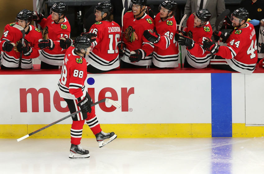CHICAGO, ILLINOIS - FEBRUARY 11: Patrick Kane #88 of the Chicago Blackhawks celebrates a goal with teammates during the third period against the Columbus Blue Jackets at the United Center on February 11, 2021 in Chicago, Illinois. (Photo by Stacy Revere/Getty Images)