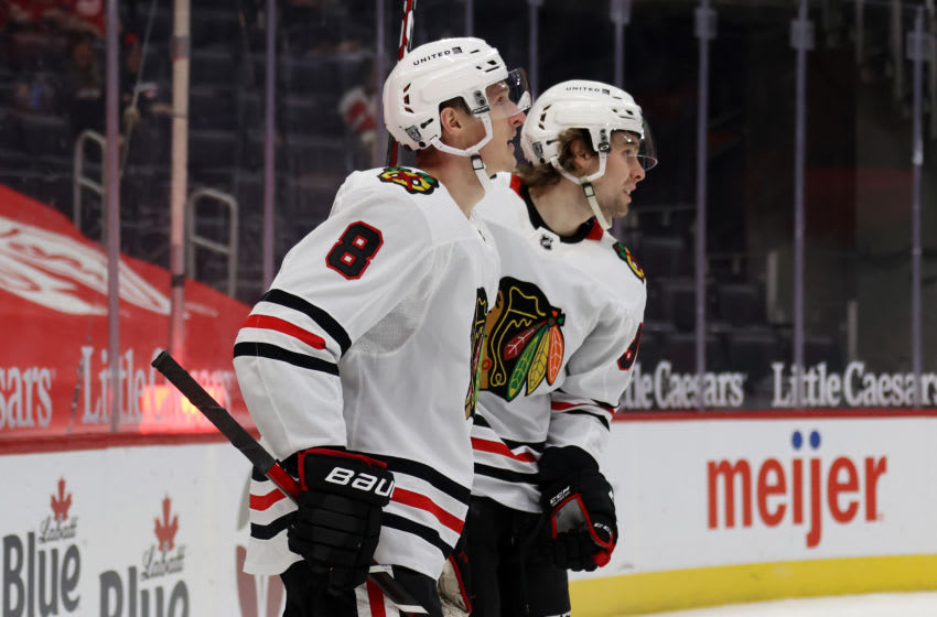 DETROIT, MICHIGAN - FEBRUARY 15: Dominik Kubalik #8 of the Chicago Blackhawks celebrates his first-period goal with Brandon Hagel #38 against the Detroit Red Wings at Little Caesars Arena on February 15, 2021 in Detroit, Michigan. (Photo by Gregory Shamus/Getty Images)