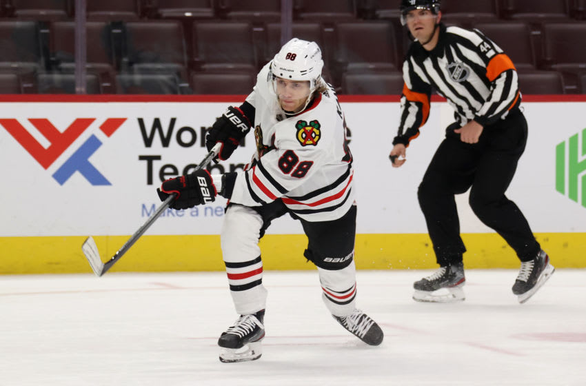 DETROIT, MICHIGAN - FEBRUARY 17: Patrick Kane #88 of the Chicago Blackhawks skates against the Detroit Red Wings at Little Caesars Arena on February 17, 2021 in Detroit, Michigan. (Photo by Gregory Shamus/Getty Images)
