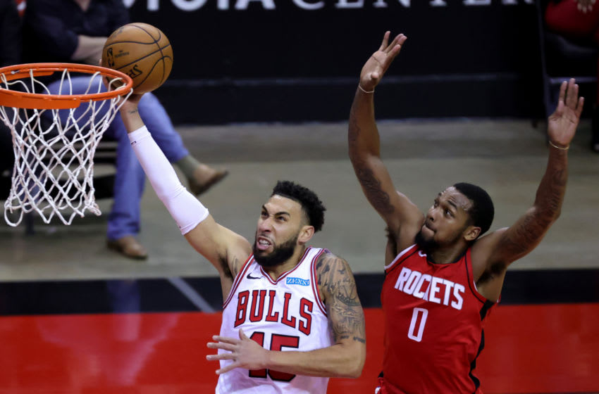 HOUSTON, TEXAS - FEBRUARY 22: Denzel Valentine #45 of the Chicago Bulls puts up a basket ahead of Sterling Brown #0 of the Houston Rockets during the fourth quarter of a game at the Toyota Center on February 22, 2021 in Houston, Texas. NOTE TO USER: User expressly acknowledges and agrees that, by downloading and or using this photograph, User is consenting to the terms and conditions of the Getty Images License Agreement. (Photo by Carmen Mandato/Getty Images)