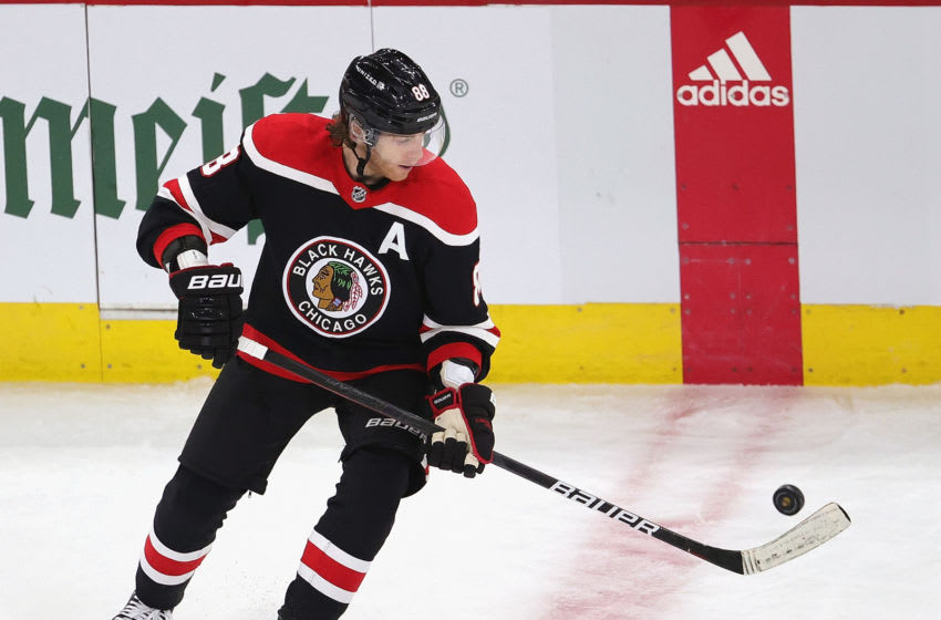 CHICAGO, ILLINOIS - FEBRUARY 28: Patrick Kane #88 of the Chicago Blackhawks takes a pass off the end of his stick against the Detroit Red Wings at the United Center on February 28, 2021 in Chicago, Illinois. (Photo by Jonathan Daniel/Getty Images)