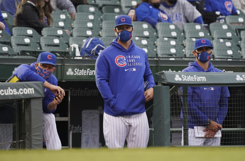 CHICAGO, ILLINOIS - APRIL 18: Manager David Ross #3 of the Chicago Cubs stands in the dugout during a game against the Atlanta Braves at Wrigley Field on April 18, 2021 in Chicago, Illinois. (Photo by Nuccio DiNuzzo/Getty Images)