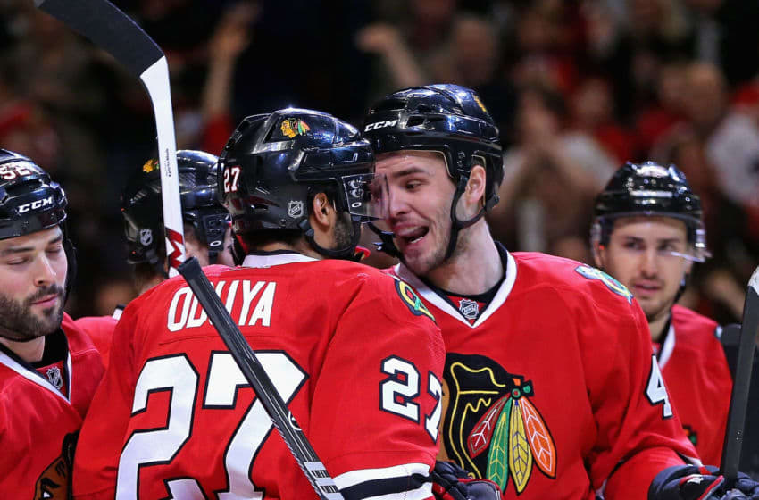 CHICAGO, IL - JANUARY 12: Niklas Hjalmarsson #4 and Johnny Oduya #27 of the Chicago Blackhawks celebrate a goal against Edmonton Oilers at the United Center on January 12, 2014 in Chicago, Illinois. The Blackhawks defeated the Oilers 5-3. (Photo by Jonathan Daniel/Getty Images)