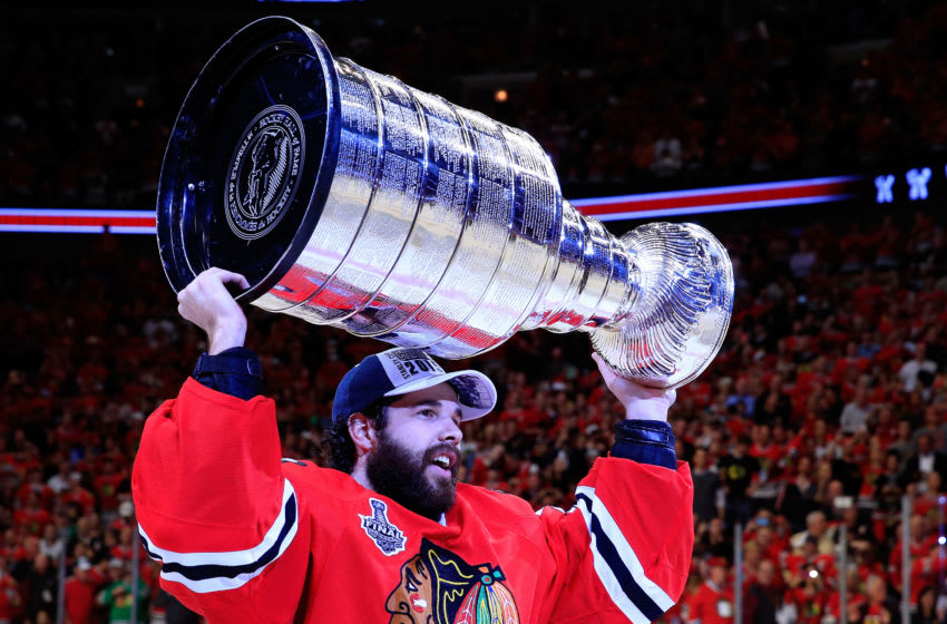 CHICAGO, IL - JUNE 15: Corey Crawford #50 of the Chicago Blackhawks celebrates by hoisting the Stanley Cup after defeating the Tampa Bay Lightning by a score of 2-0 in Game Six to win the 2015 NHL Stanley Cup Final at the United Center on June 15, 2015 in Chicago, Illinois. (Photo by Tasos Katopodis/Getty Images)