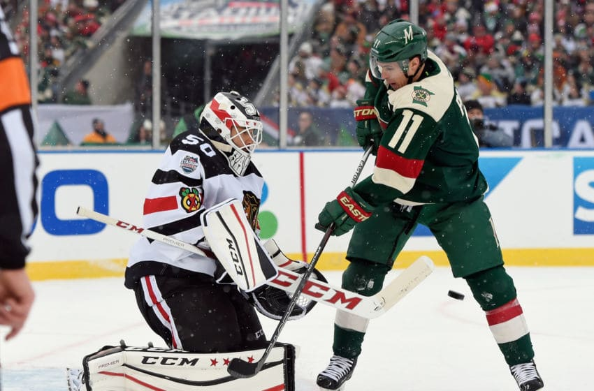 MINNEAPOLIS, MN - FEBRUARY 21: Corey Crawford #50 of the Chicago Blackhawks makes the first period stop as Zach Parise #11 of the Minnesota Wild looks for the rebound at the TCF Bank Stadium during the 2016 Coors Light Stadium Series game on February 21, 2016 in Minneapolis, Minnesota. (Photo by Hannah Foslien/Getty Images)