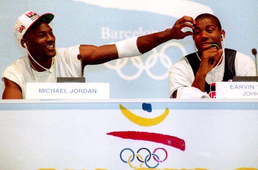 BARCELONA, SPAIN - JULY 25: Basketball stars Michael Jordan (L) and Earvin