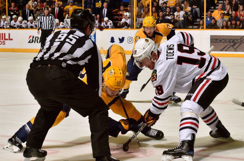 NASHVILLE, TN - MARCH 04: Jonathan Toews #19 of the Chicago Blackhawks takes a faceoff against Mike Fisher #12 of the Nashville Predators during the first period at Bridgestone Arena on March 4, 2017 in Nashville, Tennessee. (Photo by Frederick Breedon/Getty Images)