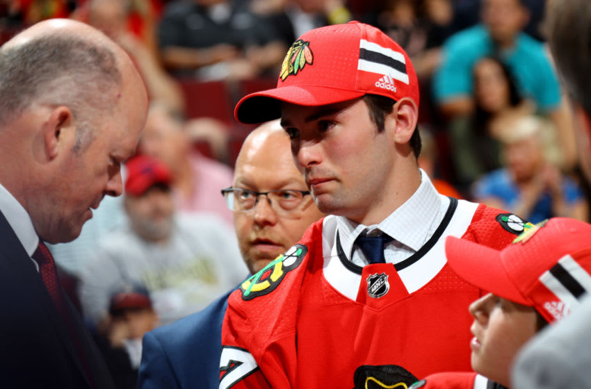 CHICAGO, IL - JUNE 24: Evan Barratt meets with Chicago Blackhawks general manager Stan Bowman after being selected 90th overall during the 2017 NHL Draft at the United Center on June 24, 2017 in Chicago, Illinois. (Photo by Bruce Bennett/Getty Images)