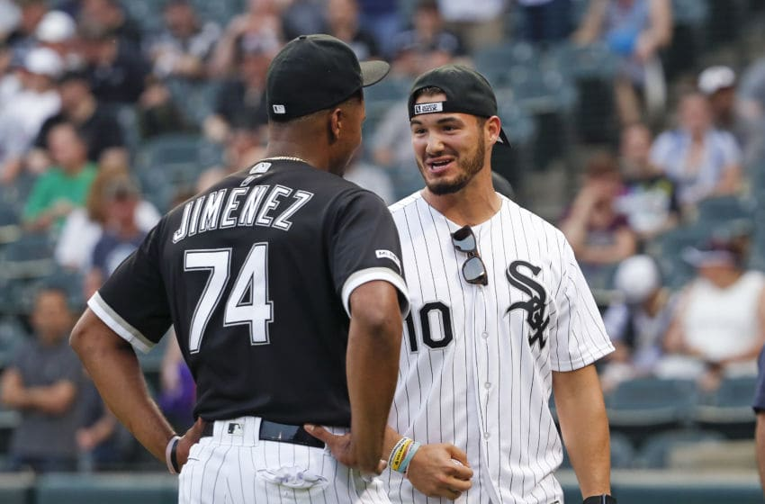 CHICAGO, ILLINOIS - MAY 31: Eloy Jimenez #74 of the Chicago White Sox speaks with Chicago Bears quarterback Mitch Trubisky before the game against the Cleveland Indians at Guaranteed Rate Field on May 31, 2019 in Chicago, Illinois. (Photo by Nuccio DiNuzzo/Getty Images)