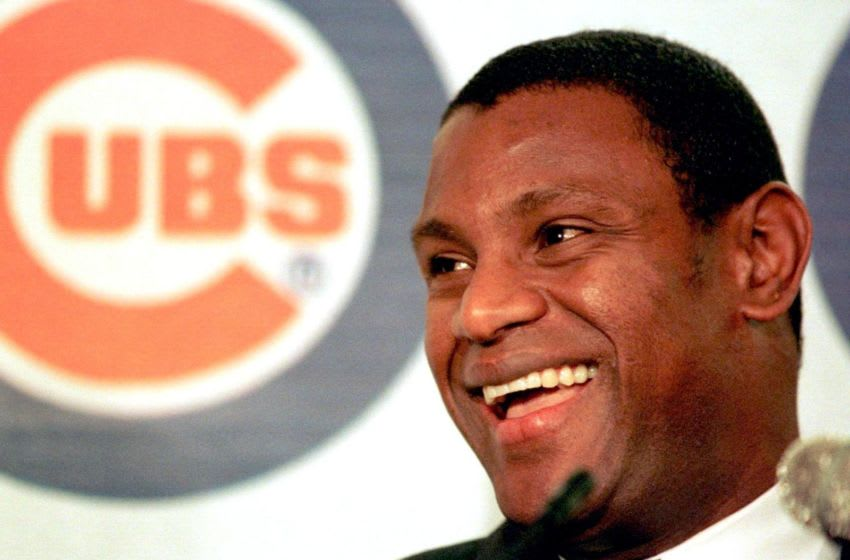 CHICAGO, UNITED STATES: Sammy Sosa of the Chicago Cubs speaks at a press conference at Wrigley Field in Chicago 19 November after he was named National League Most Valuable Player. Sosa received 30 of 32 first place votes. AFP PHOTO/JOHN ZICH (Photo credit should read JOHN ZICH/AFP via Getty Images)