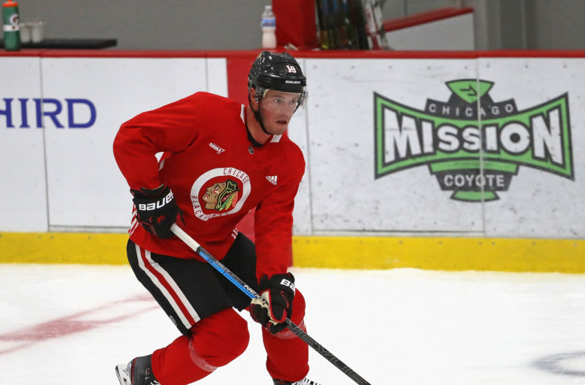 CHICAGO, ILLINOIS - JULY 14: Jonathan Toews #19 of the Chicago Blackhawks advances the puck during a summer training camp practice at Fifth Third Arena on July 14, 2020 in Chicago, Illinois. (Photo by Jonathan Daniel/Getty Images)
