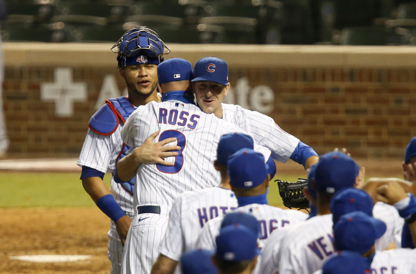 CHICAGO, ILLINOIS - JULY 24: Manger David Ross #3 and Kyle Hendricks #28 of the Chicago Cubs celebrate after a win over the Milwaukee Brewers on opening day at Wrigley Field on July 24, 2020 in Chicago, Illinois. The 2020 season had been postponed since March due to the COVID-19 pandemic. (Photo by Justin Casterline/Getty Images)