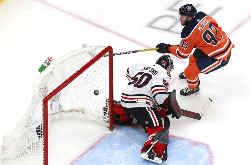 EDMONTON, ALBERTA - AUGUST 03: Connor McDavid #97 of the Edmonton Oilers scores his second goal against Corey Crawford #50 of the Chicago Blackhawks during the first period in Game Two of the Western Conference Qualification Round prior to the 2020 NHL Stanley Cup Playoffs at Rogers Place on August 03, 2020 in Edmonton, Alberta. (Photo by Jeff Vinnick/Getty Images)