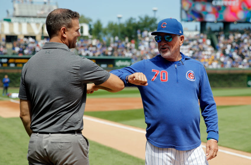 Aug 22, 2019; Chicago, IL, USA; Chicago Cubs President of Baseball Operations Theo Epstein and manager Joe Maddon (70) greet each other with an elbow bump before the game against the San Francisco Giants at Wrigley Field. Mandatory Credit: Jon Durr-USA TODAY Sports