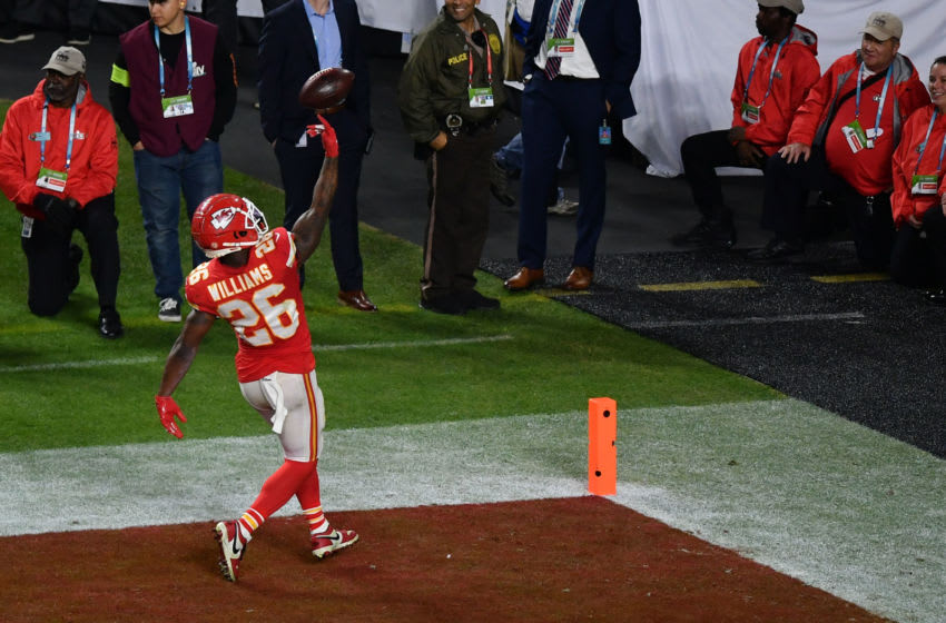 Feb 2, 2020; Miami Gardens, Florida, USA; Kansas City Chiefs running back Damien Williams (26) runs the ball in for a touchdown during the fourth quarter against the San Francisco 49ers in Super Bowl LIV at Hard Rock Stadium. Mandatory Credit: Jasen Vinlove-USA TODAY Sports