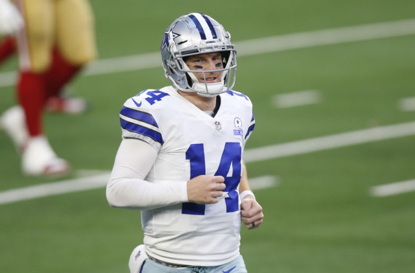Dec 20, 2020; Arlington, Texas, USA; Dallas Cowboys quarterback Andy Dalton (14) reacts after a touchdown against the San Francisco 49ers in the fourth quarter at AT&T Stadium. Mandatory Credit: Tim Heitman-USA TODAY Sports