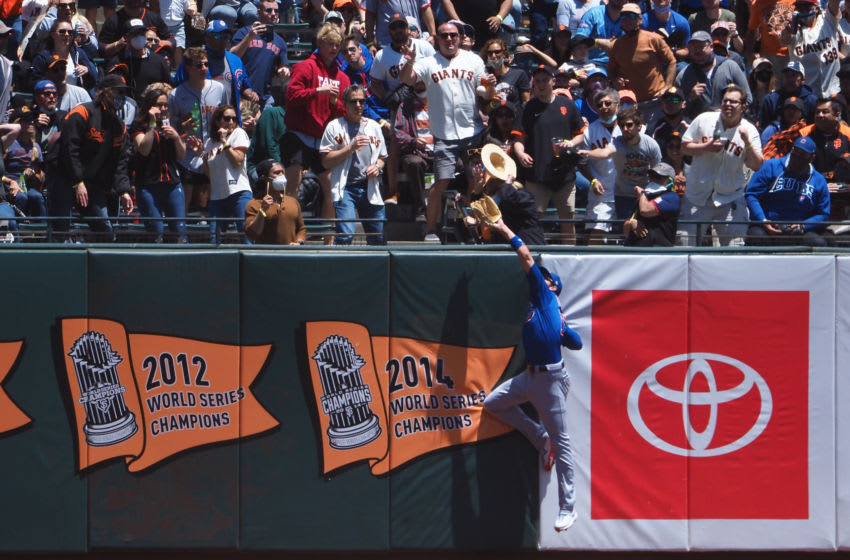 Jun 6, 2021; San Francisco, California, USA; Chicago Cubs left fielder Kris Bryant (17) jumps along the wall but is unable to catch the ball for a San Francisco Giants home run during the first inning at Oracle Park. Mandatory Credit: Kelley L Cox-USA TODAY Sports