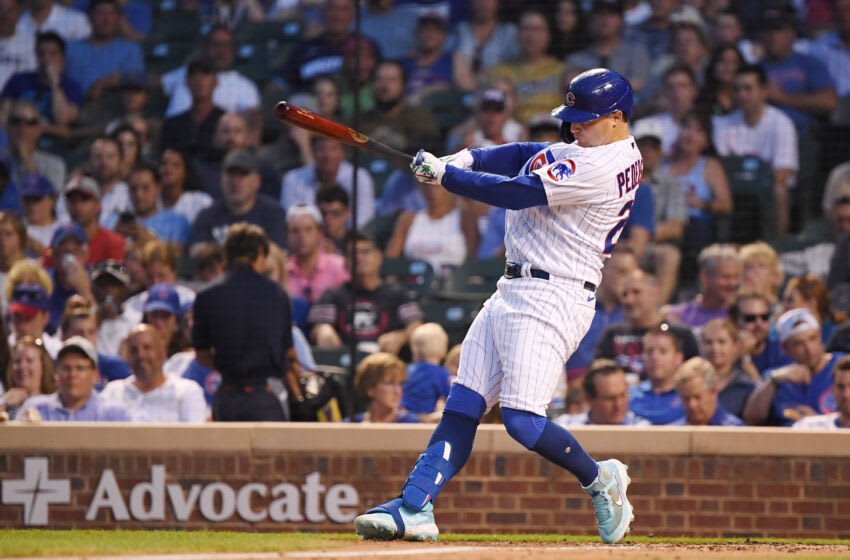Jul 6, 2021; Chicago, Illinois, USA; Chicago Cubs left fielder Joc Pederson (24) hits a RBI single in the third inning against the Philadelphia Phillies at Wrigley Field. Mandatory Credit: Quinn Harris-USA TODAY Sports