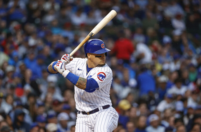 Jul 10, 2021; Chicago, Illinois, USA; Chicago Cubs shortstop Javier Baez (9) bats against the St. Louis Cardinals during the first inning at Wrigley Field. Mandatory Credit: Kamil Krzaczynski-USA TODAY Sports