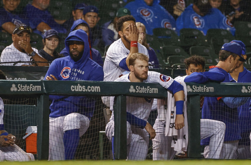 Jul 10, 2021; Chicago, Illinois, USA; Chicago Cubs right fielder Jason Heyward (22) and catcher Willson Contreras (40) and center fielder Ian Happ (8) look on from a dugout during the eight inning against the St. Louis Cardinals at Wrigley Field. Mandatory Credit: Kamil Krzaczynski-USA TODAY Sports