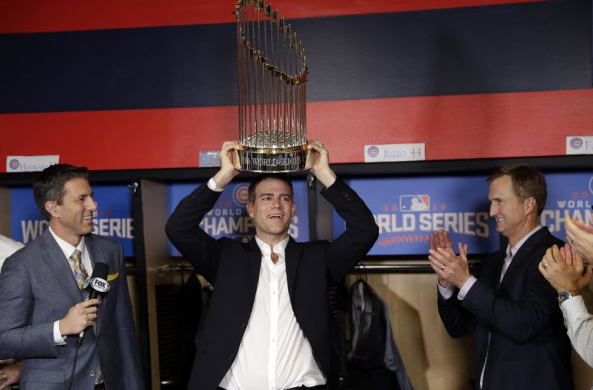 Nov 2, 2016; Cleveland, OH, USA; Chicago Cubs president Theo Epstein holds the commissioner's trophy after game seven of the 2016 World Series against the Cleveland Indians at Progressive Field. Mandatory Credit: David J. Phillip/Pool Photo via USA TODAY Sports