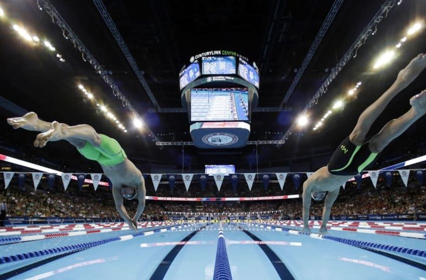 Jun 26, 2016; Omaha, NE, USA; Ryan Lochte (left) and Chase Kalisz (right) dive into the pool at the start of the men