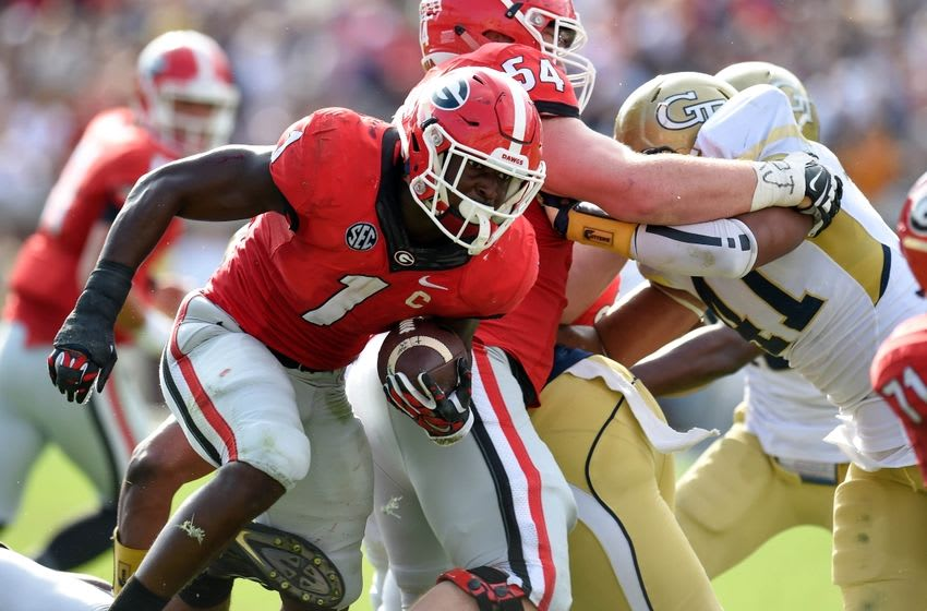 Nov 28, 2015; Atlanta, GA, USA; Georgia Bulldogs running back Sony Michel (1) breaks a tackle by Georgia Tech Yellow Jackets defensive lineman Patrick Gamble (91) during the second half at Bobby Dodd Stadium. Georgia defeated Georgia Tech 13-7. Mandatory Credit: Dale Zanine-USA TODAY Sports