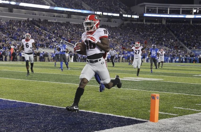 Nov 5, 2016; Lexington, KY, USA; Georgia Bulldogs wide receiver Isaiah McKenzie (16) runs the ball for a touchdown against the Kentucky Wildcats in the first quarter at Commonwealth Stadium. Mandatory Credit: Mark Zerof-USA TODAY Sports