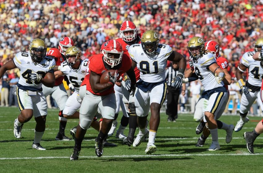 Nov 26, 2016; Athens, GA, USA; Georgia Bulldogs running back Sony Michel (1) runs for a touchdown against the Georgia Tech Yellow Jackets during the first quarter at Sanford Stadium. Mandatory Credit: Dale Zanine-USA TODAY Sports
