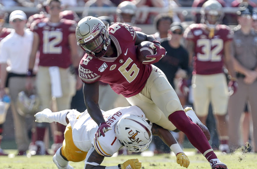 TALLAHASSEE, FL - SEPTEMBER 7: Tight End Tre' McKitty #6 of the Florida State Seminoles avoids a tackle by Safety Tyler Glass #1 of the Louisiana Monroe Warhawks during the game at Doak Campbell Stadium on Bobby Bowden Field on September 7, 2019 in Tallahassee, Florida. (Photo by Don Juan Moore/Getty Images)