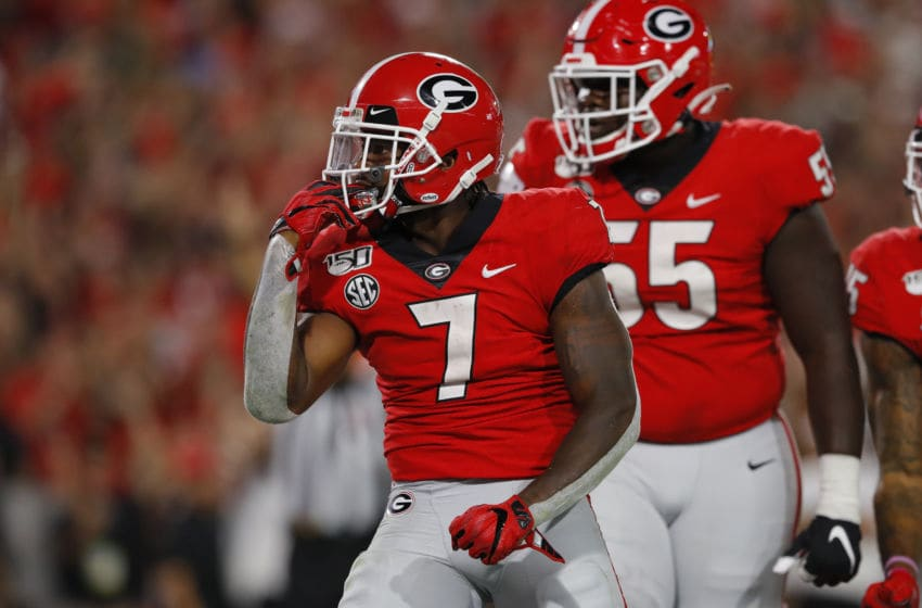 ATHENS, GEORGIA - SEPTEMBER 21: D'Andre Swift #7 of the Georgia Bulldogs celebrates his second quarter touchdown with Trey Hill #55 while playing the Notre Dame Fighting Irish at Sanford Stadium on September 21, 2019 in Athens, Georgia. (Photo by Kevin C. Cox/Getty Images)
