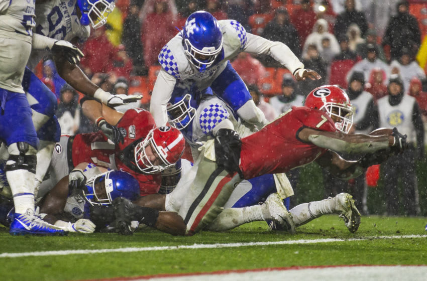 ATHENS, GA - OCTOBER 19: D'Andre Swift #7 of the Georgia Bulldogs runes for a three yard touchdown during the second half of a game against the Kentucky Wildcats at Sanford Stadium on October 19, 2019 in Athens, Georgia. (Photo by Carmen Mandato/Getty Images)