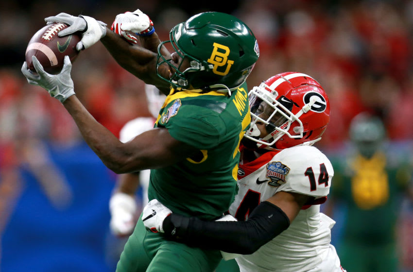 NEW ORLEANS, LOUISIANA - JANUARY 01: Denzel Mims #5 of the Baylor Bears catches a pass over DJ Daniel #14 of the Georgia Bulldogs during the Allstate Sugar Bowl at Mercedes Benz Superdome on January 01, 2020 in New Orleans, Louisiana. (Photo by Sean Gardner/Getty Images)