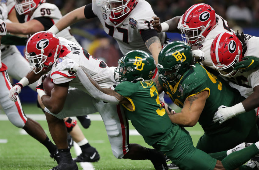 NEW ORLEANS, LOUISIANA - JANUARY 01: Running back Zamir White #3 of the Georgia Bulldogs runs the ball during the first quarter against Baylor Bears during the Allstate Sugar Bowl at Mercedes Benz Superdome on January 01, 2020 in New Orleans, Louisiana. (Photo by Marianna Massey/Getty Images)