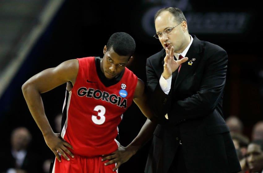 CHARLOTTE, NC - MARCH 18: Head coach Mark Fox of the Georgia Bulldogs talks with Dustin Ware