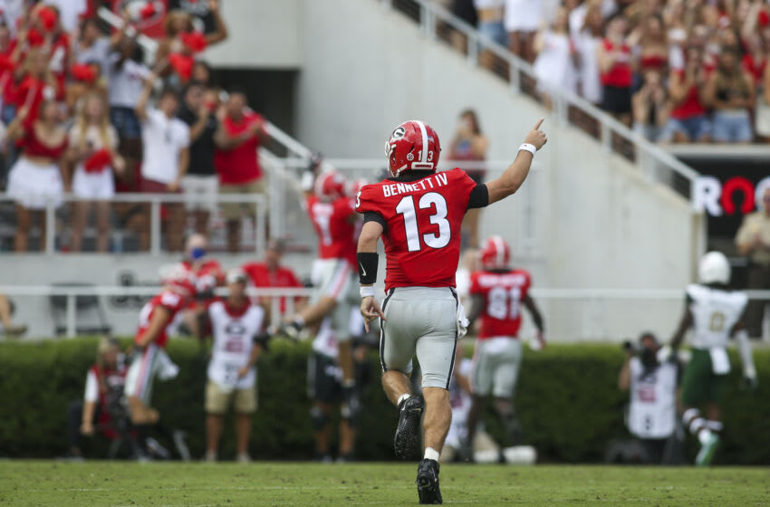 Stetson Bennett celebrates after a touchdown throw against UAB. (Photo by Brett Davis/Getty Images)