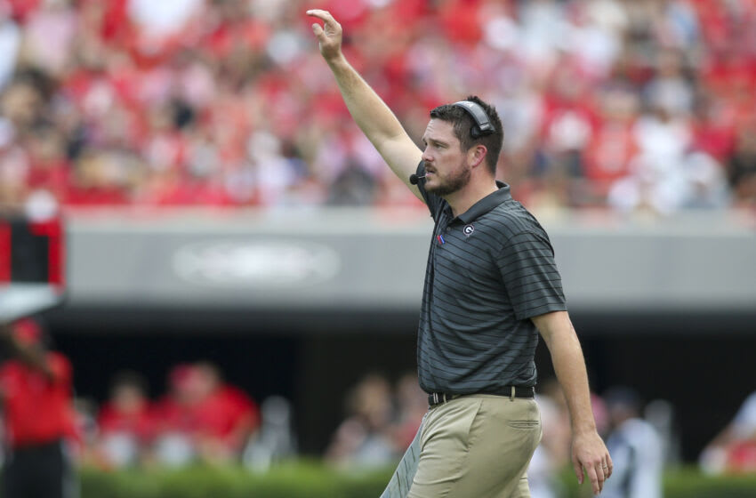ATHENS, GA - SEPTEMBER 11: Defensive coordinator Dan Lanning of the Georgia Bulldogs calls a play against the UAB Blazers in the first half at Sanford Stadium on September 11, 2021 in Athens, Georgia. (Photo by Brett Davis/Getty Images)