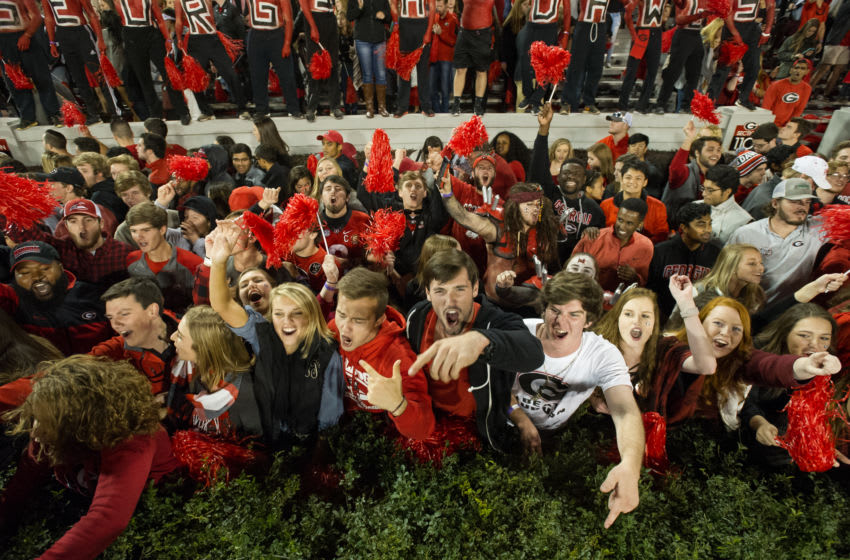 ATHENS, GA - NOVEMBER 12: Fans of the Georgia Bulldogs celebrate after defeating the Auburn Tigers at Sanford Stadium on November 12, 2016 in Athens, Georgia. The Georgia Bulldogs defeated the Auburn Tigers 13-7. (Photo by Michael Chang/Getty Images)
