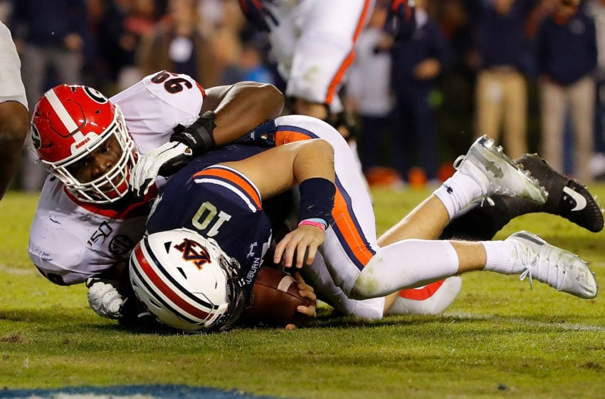 AUBURN, ALABAMA - NOVEMBER 16: Bo Nix #10 of the Auburn Tigers dives for a touchdown against Jordan Davis #99 of the Georgia Bulldogs in the second half at Jordan-Hare Stadium on November 16, 2019 in Auburn, Alabama. (Photo by Kevin C. Cox/Getty Images)