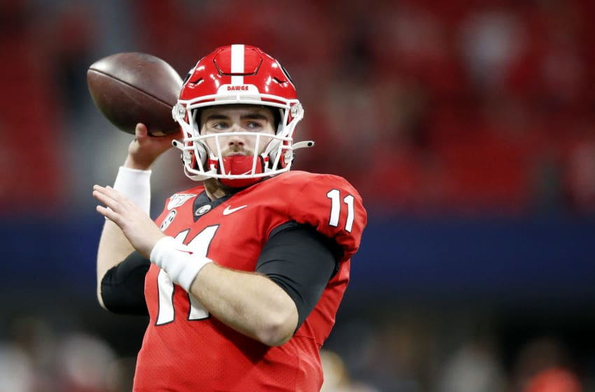 ATLANTA, GEORGIA - DECEMBER 07: Jake Fromm #11 of the Georgia Bulldogs warms up before the SEC Championship game against the LSU Tigers at Mercedes-Benz Stadium on December 07, 2019 in Atlanta, Georgia. (Photo by Todd Kirkland/Getty Images)