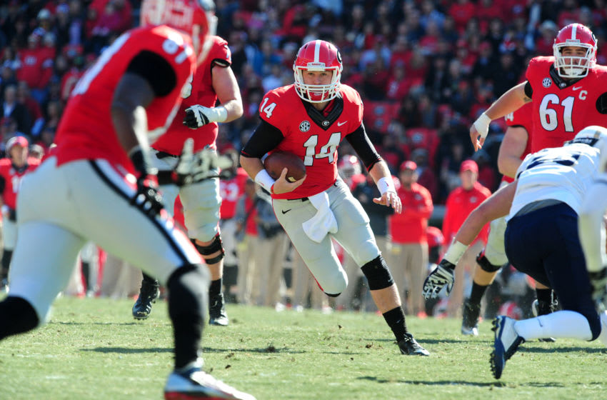 ATHENS, GA - NOVEMBER 22: Hutson Mason #14 of the Georgia Bulldogs scrambles against the Charleston Southern Buccaneers at Sanford Stadium on November 22, 2014 in Athens, Georgia. (Photo by Scott Cunningham/Getty Images)
