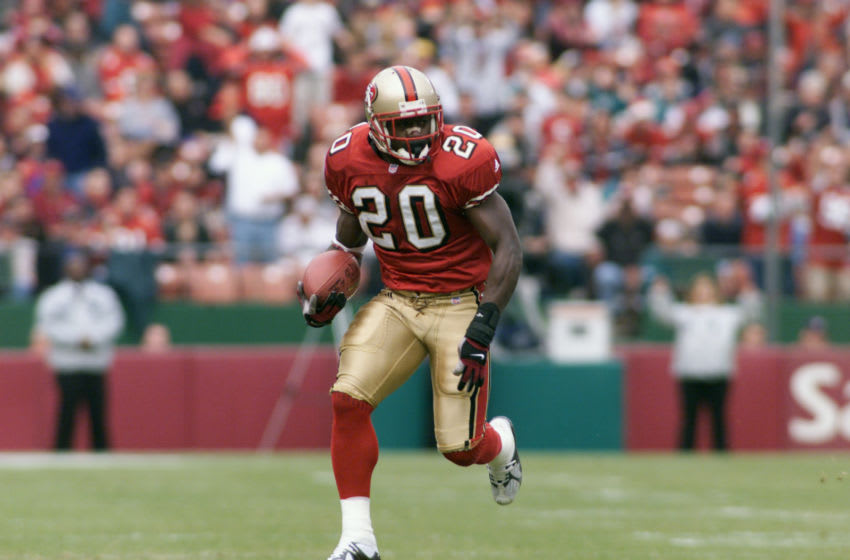 16 Dec 2001: Garrison Hearst of the San Franciso 49ers heads downfield against the Miami Dolphins during the game at 3Com Park in San Francisco, California. DIGITAL IMAGE. Mandatory Credit: Jed Jacobsohn/Getty Images