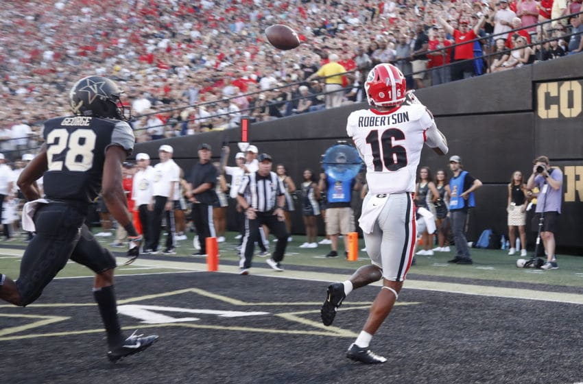 NASHVILLE, TENNESSEE - AUGUST 31: Demetris Robertson #16 of the Georgia Bulldogs makes a touchdown reception during the first half at Vanderbilt Stadium on August 31, 2019 in Nashville, Tennessee. (Photo by Frederick Breedon/Getty Images)